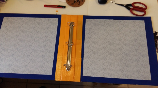 Attached the covers to the spine using duct tape, leaving small gaps to allow for opening and closing the album.